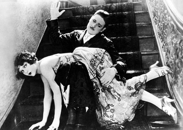 Man spanking woman on stairs Picture from Photolibrary