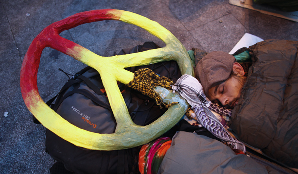 Demonstrators camp out in Madrid's Puerta del Sol during eighth day of protests