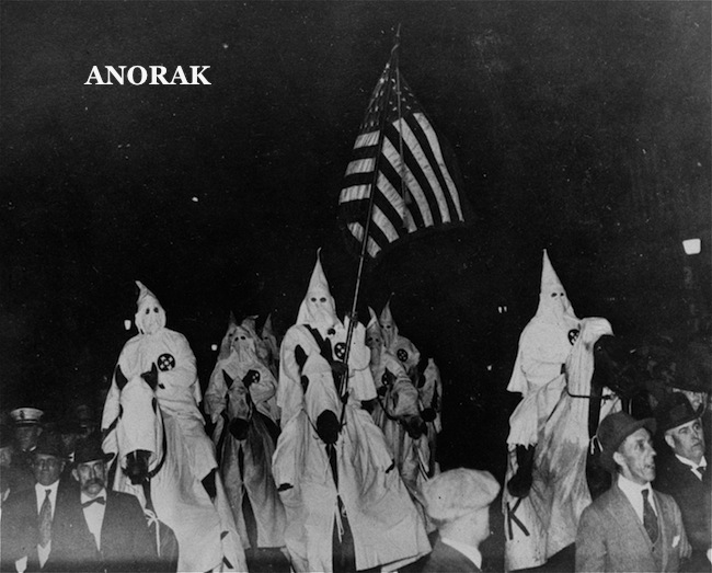 An unusual photo depicting the Ku Klux Klan in their regalia parading through the streets of Tulsa, Oklahoma, September 21, 1923, while the former Sheriff Bill McCullough, whose efforts to stop the parade were fruitless, can be seen to the left of the hooded horse, note the uniformed police marching alongside the Klansmen. (AP Photo)